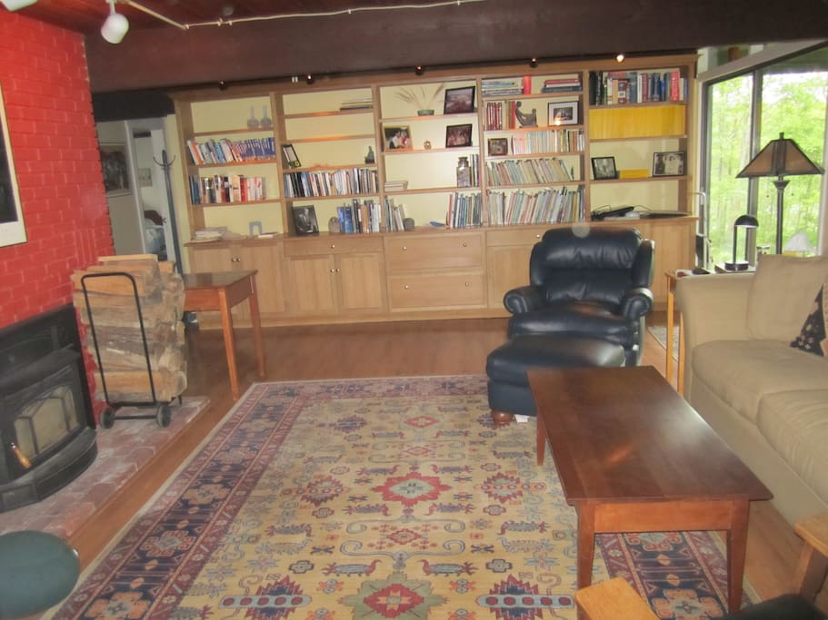 Living room for guest use includes TV, dvd player, woodstove.