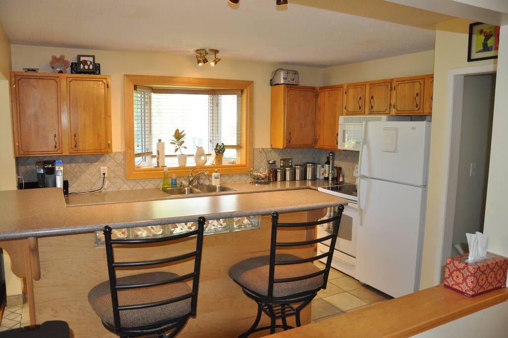 KITCHEN: Breakfast bar, K-cup coffee maker, standard appliances including dishwasher.