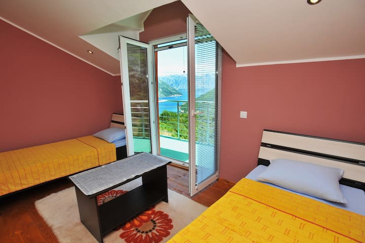 Room 2 with a panorama view on the Kotor Bay