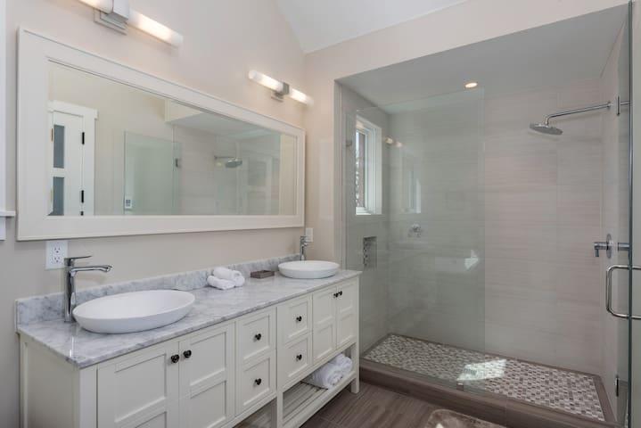 The master en-suite bathroom features a glass-door shower and heated floors.