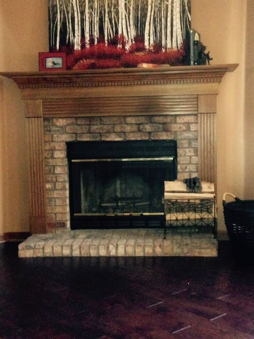 wood-burning fire place. Wood floors throughout except in rooms.