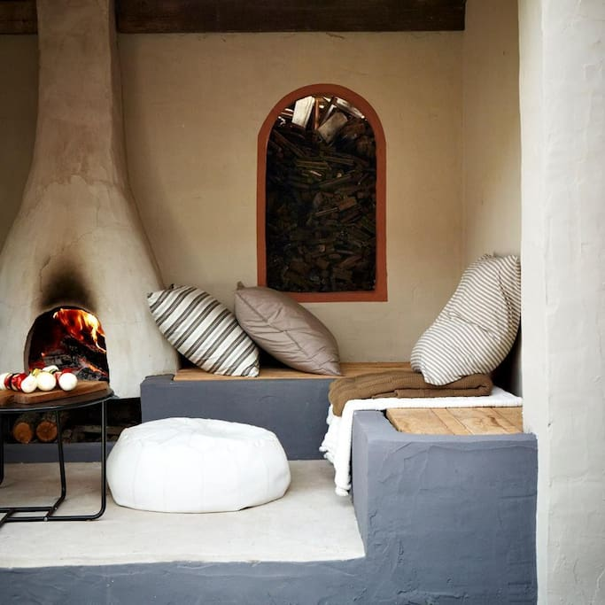 outdoor lounge with fireplace