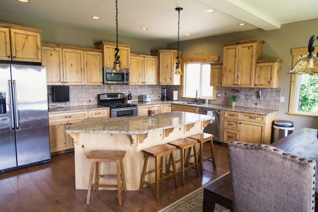 Large gourmet eat-in kitchen with center island and seating for 20.