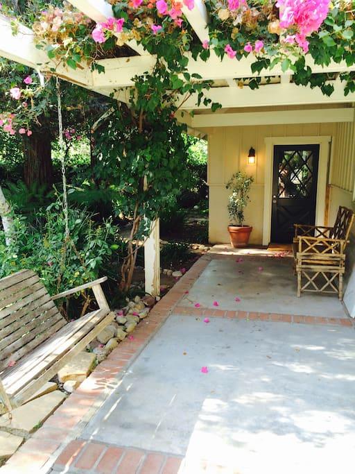 Bouganvilla covered arbor entrance.
