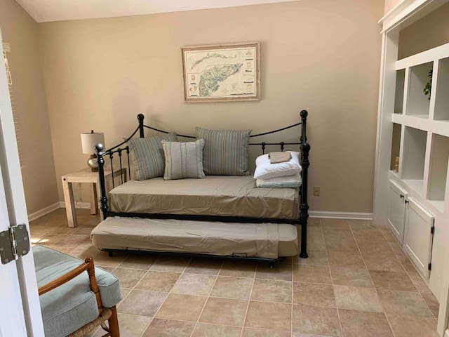 Third bedroom trundle twins with space for air mattress - window to front porch