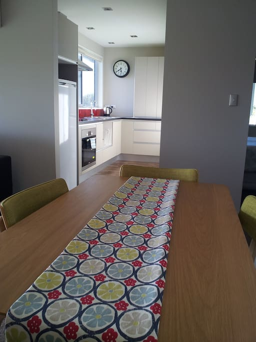 Dining table - seats four. Kitchen with cook top, oven, fridge, cutlery & crockery for four. Includes plunger for coffee or tea.