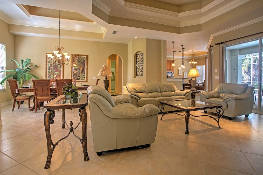 Relax in the living room with leather sofas and a flat-screen cable TV.