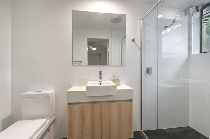 Very clean and very modern shower/toilet