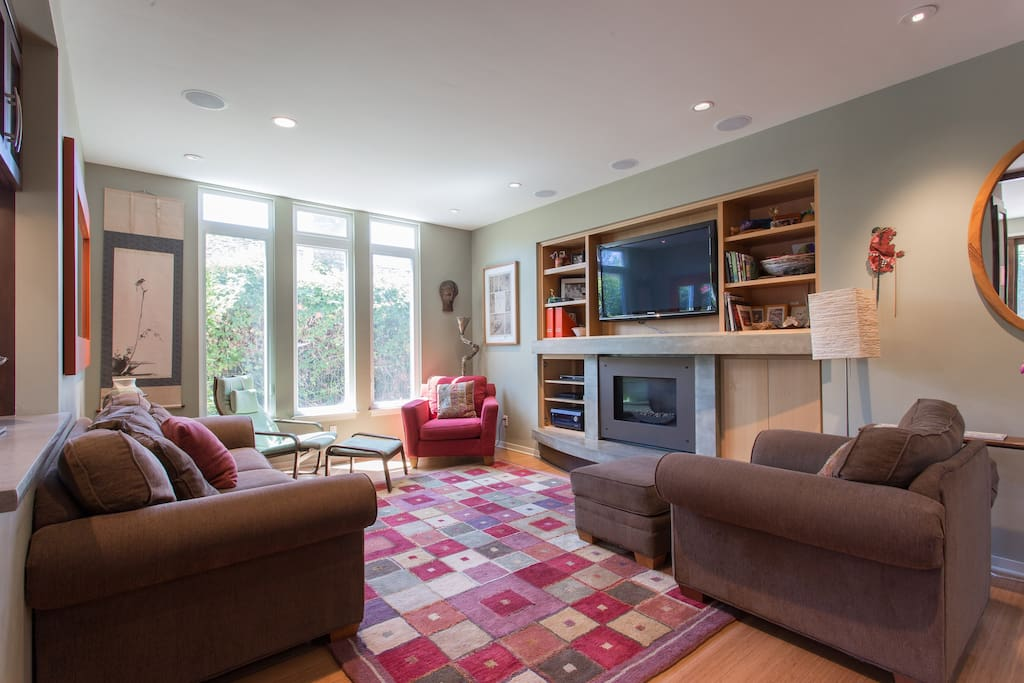 Enjoy full surround sound speaker system, cable, Netflix, and a gas fireplace.