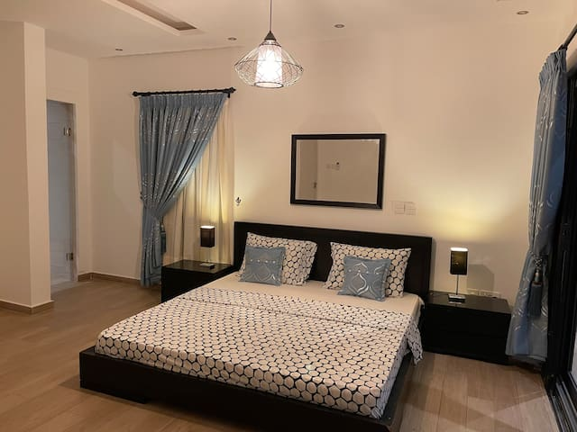 Master suite with a super king size bed + 2 side drawers