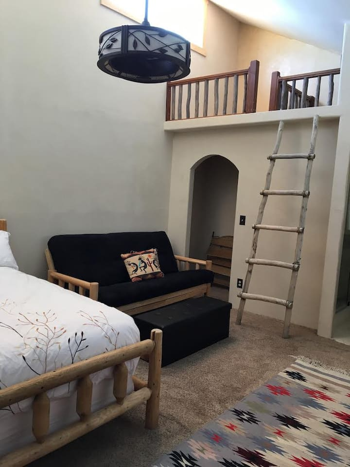 Master bedroom has two queen-size beds. One in aspen/pine log frame, and the other a pull-out futon. Both super comfortable!