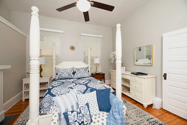 Lovely and spacious master bedroom with 4-poster bed and queen mattress. Plenty of closet space and areas for unpacking.  Each bedroom has its own USB charger on the nightstand.