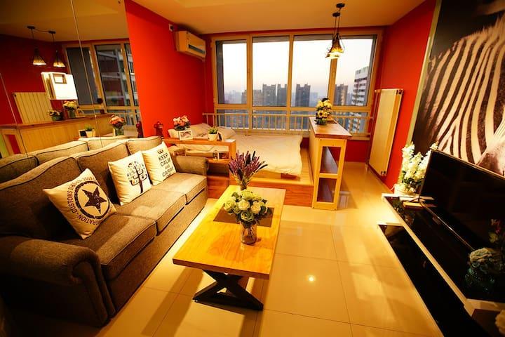 CBD万达浪漫蜜月情侣爱巢经典大床房 中央CBD精装酒店式公寓 - Qingdao - Apartament