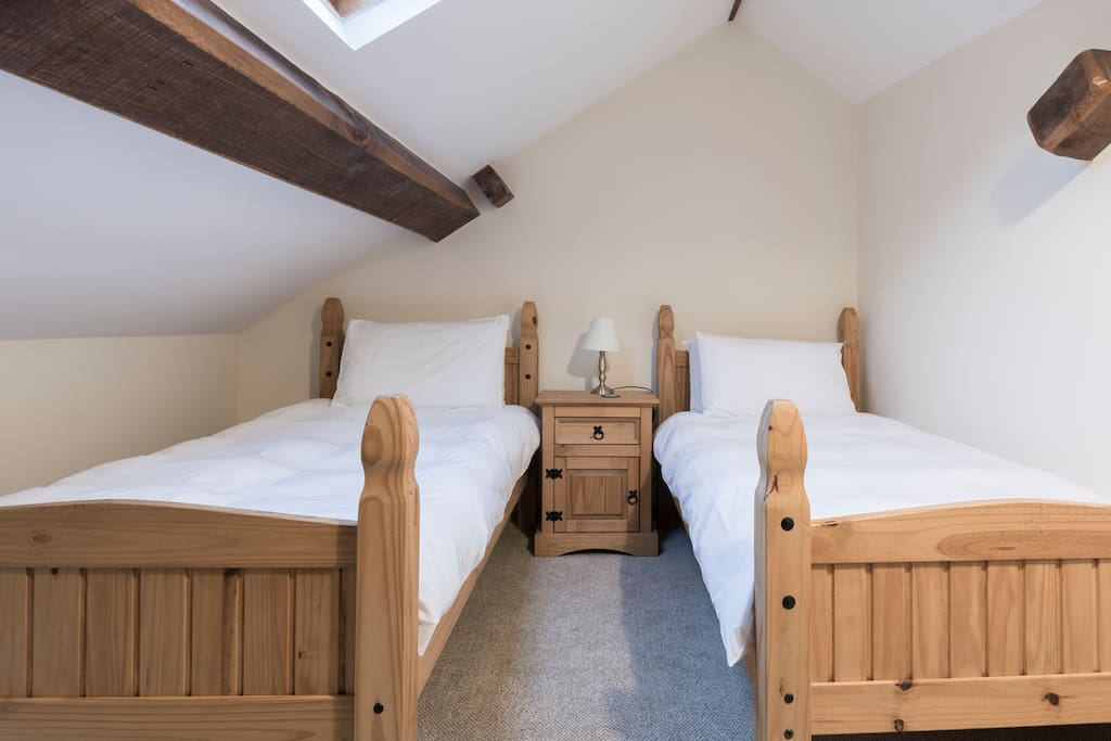 A twin bedroom accessed through the galleried bedroom.