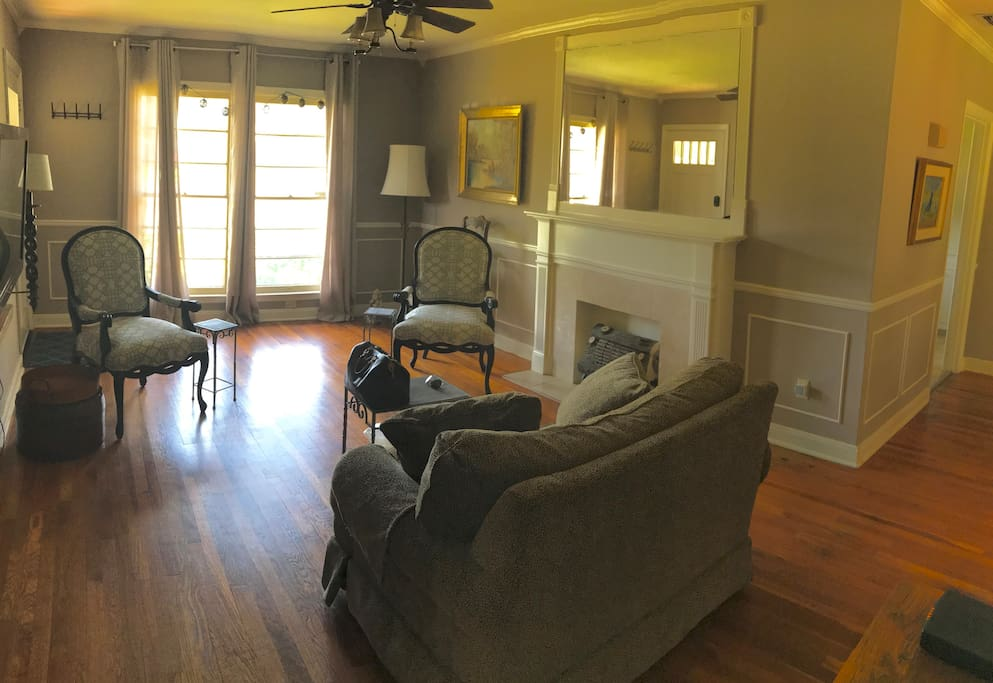Living Room with giant windows looking out the front of the house and plenty of cheerful West Texas sunlight!