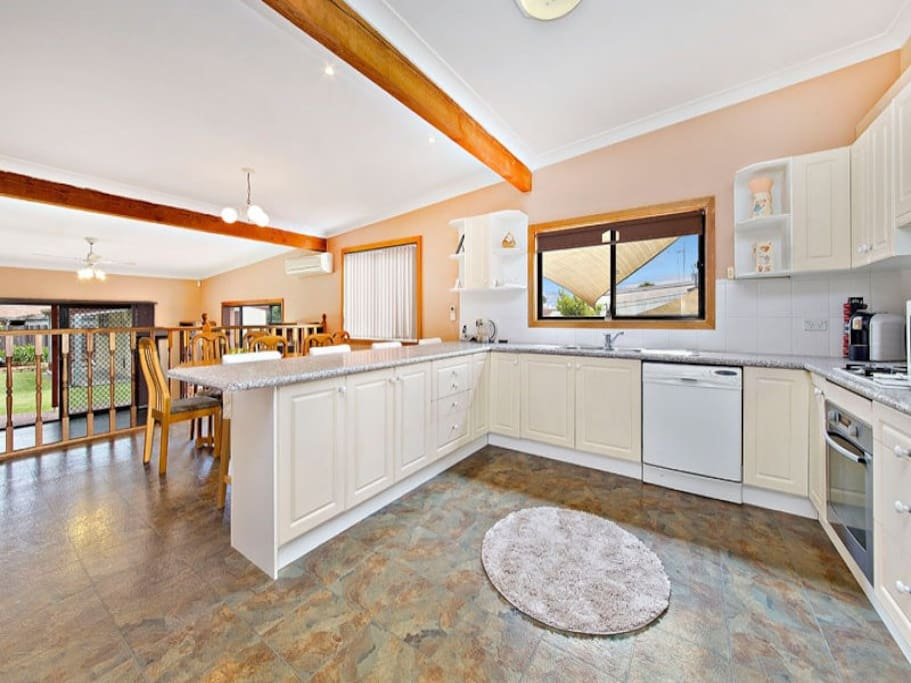 Huge family kitchen with open plan dinning that faces garden views