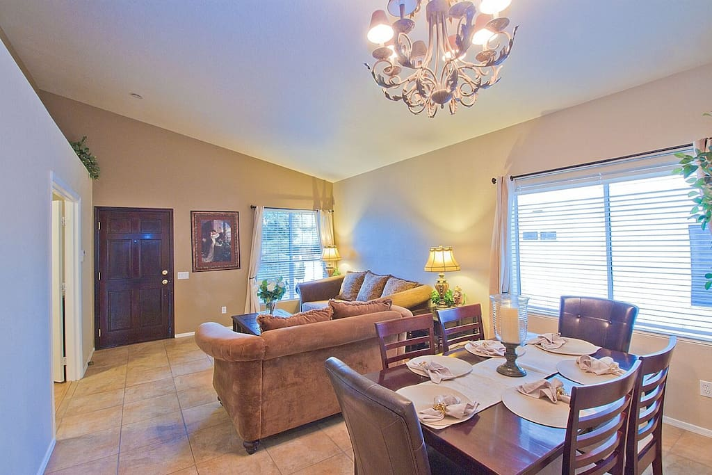 Formal dining table sits 6, with aditional 8 sittings in kitchen area, and 6 more at patio table.