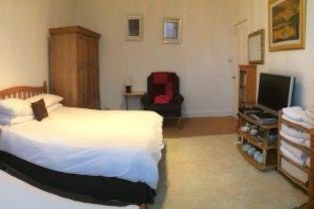 Guest room 2015 with 12-15 towels which are laundered as you use them     Plates cups bowls cutlery for use with microwave and fridge plus tea making facilities