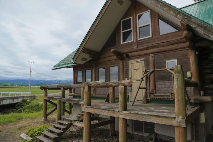 log cabin in BIEI's forest.