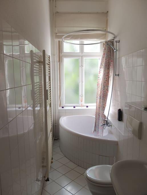 Sunny Bathroom with oval bath and shower!