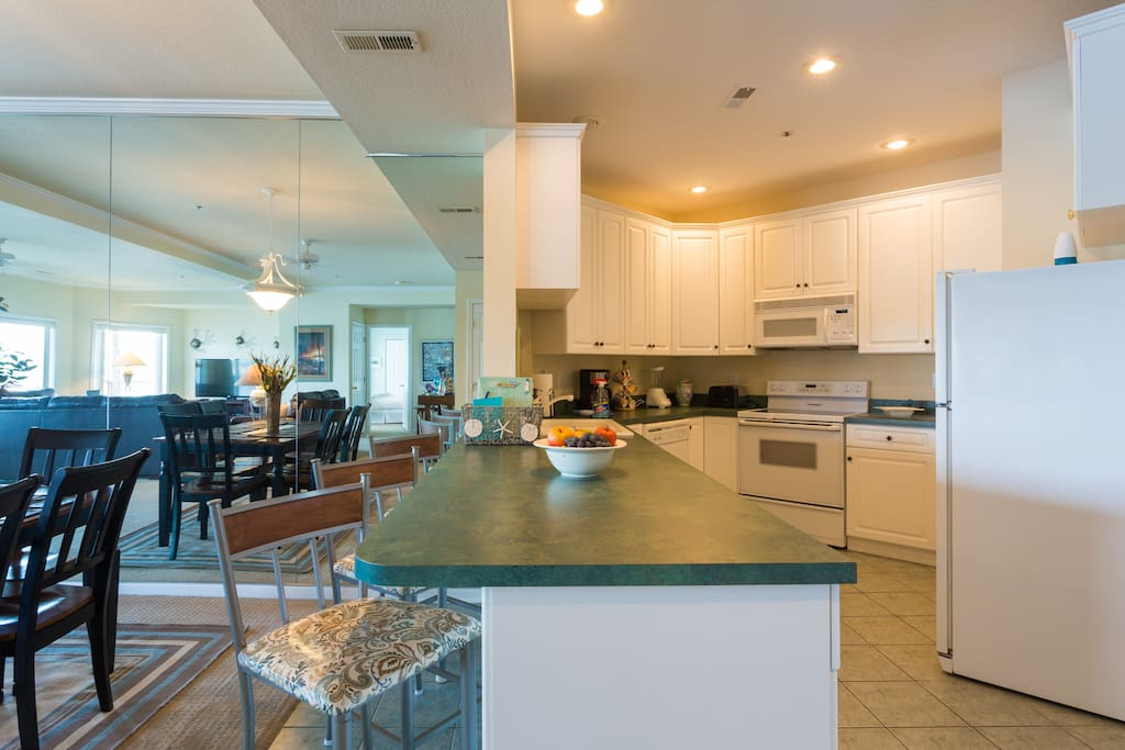 Large, fully equipped kitchen with counter seating.