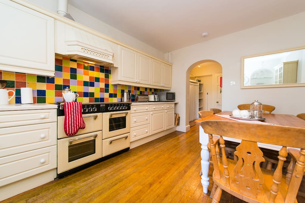 A very well equipped eat-in kitchen with side by side fridge and freezer and range cooker