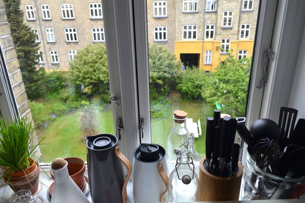 The view from our kitchen window is a private garden, which is shared by approximately 21 apartments. Sandbox and the opportunity to use a grill.