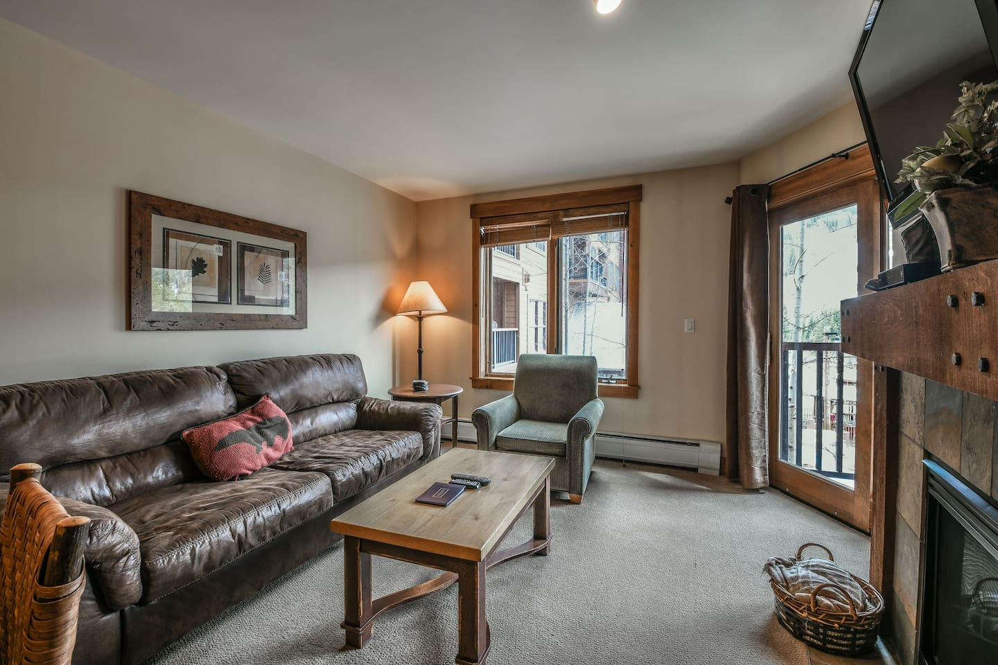 Living room with upper level balcony access