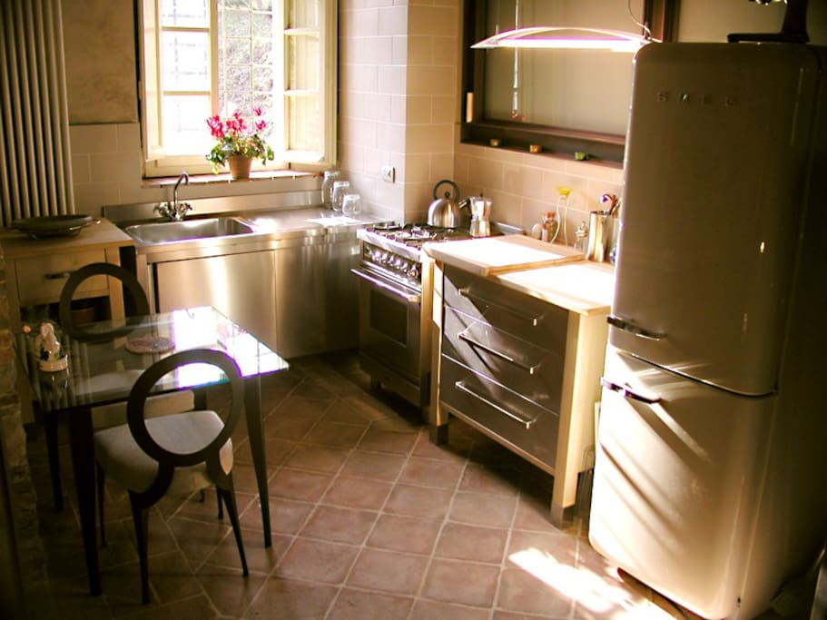Full kitchen with all utensils.