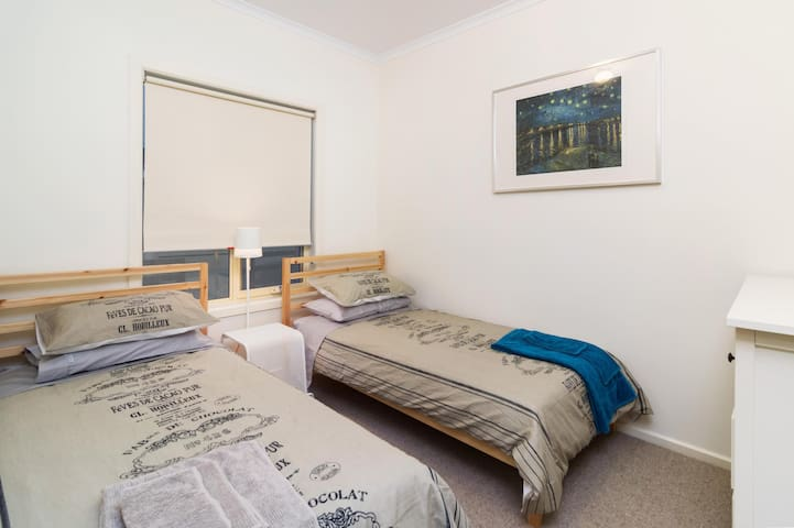 TWO COMFY SINGLE BEDS WITH DOONAS