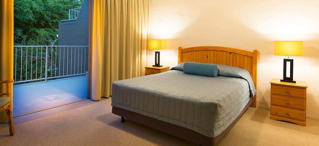 Master bedroom - queen bed, ensuite, walk-in wardrobe, balcony access