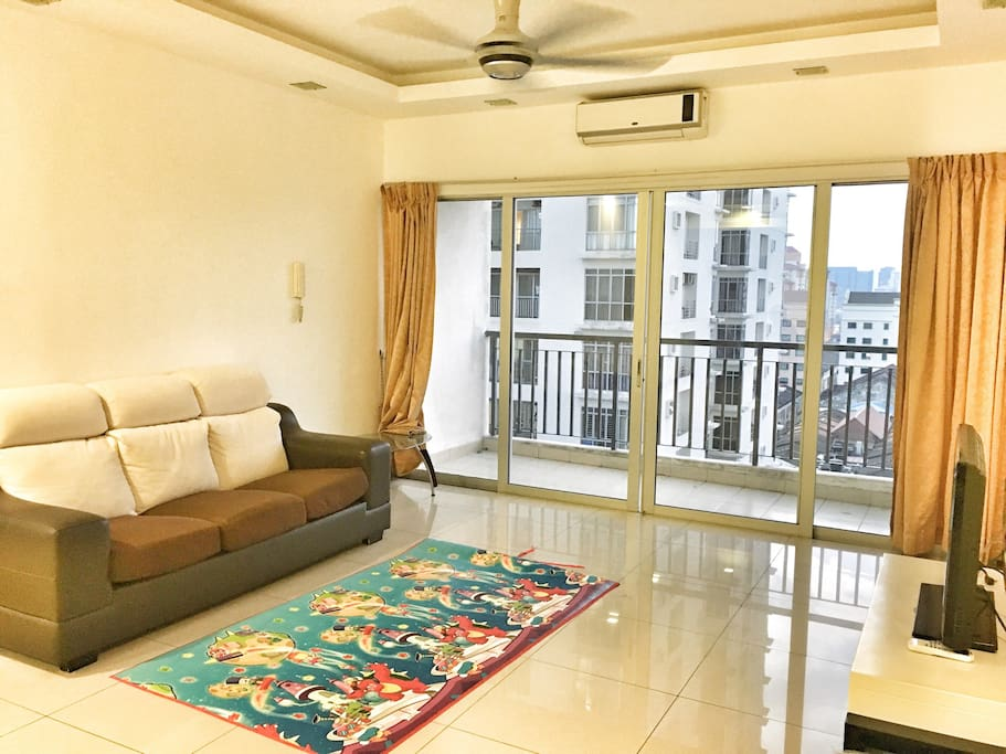 Living room with sofa, TV, air condition, ceiling fan & balcony