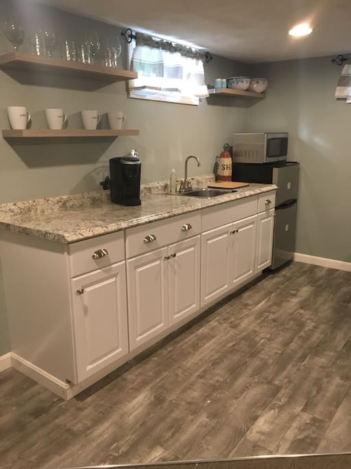Kitchenette area, with microwave, refrigerator, keurig, and sink.