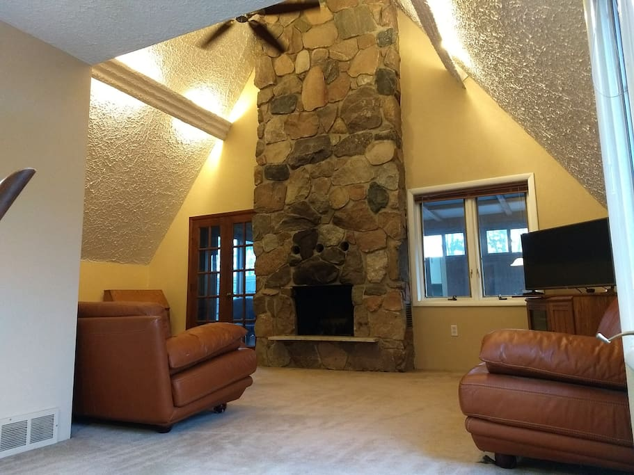 2-story stone fireplace -patio through french doors