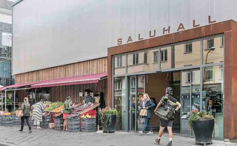 You can find all sorts of good food at Salulhallen, Östermalmstorg about 20 minutes walk from the apartment (or one stop with the metro)