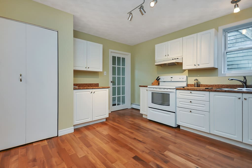 You'll enter our house through the glass pane door and instantly enjoy the hardwood floors.