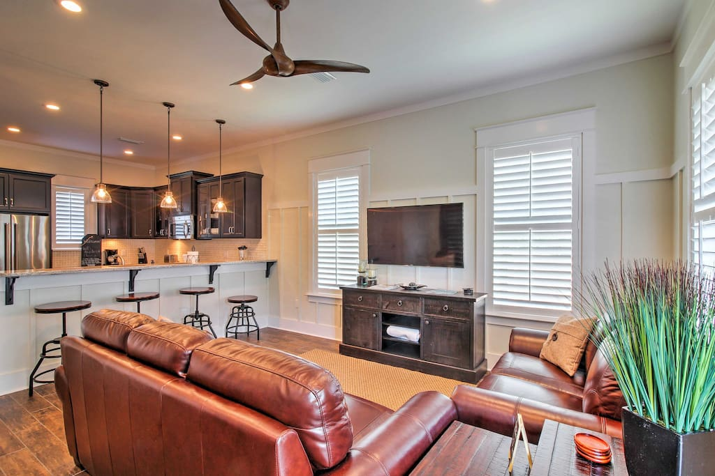 Wood flooring, comfortable and clean decor, and ample lighting welcomes you into the home.