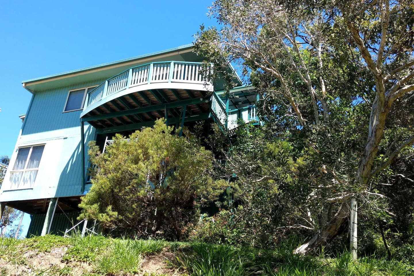 Beautiful beach house with great  views and tree top position.  Unique frontage position with no houses between you and the beach - only a couple of minutes walk