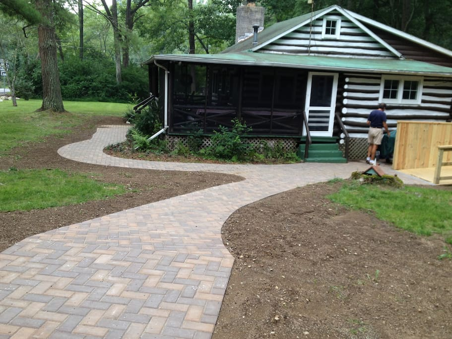 New paved sidewalk to ramp from deck make bedrooms and bathroom wheelchair accessible.
