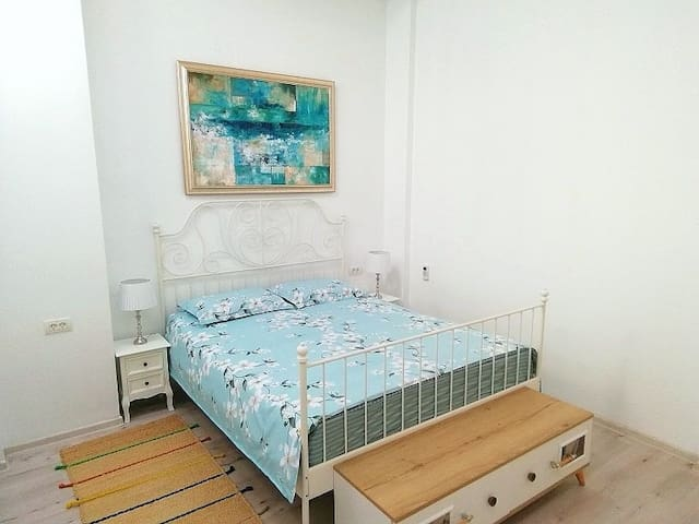 First bedroom with king size bed, large wardrobe, heater and air conditioning unit