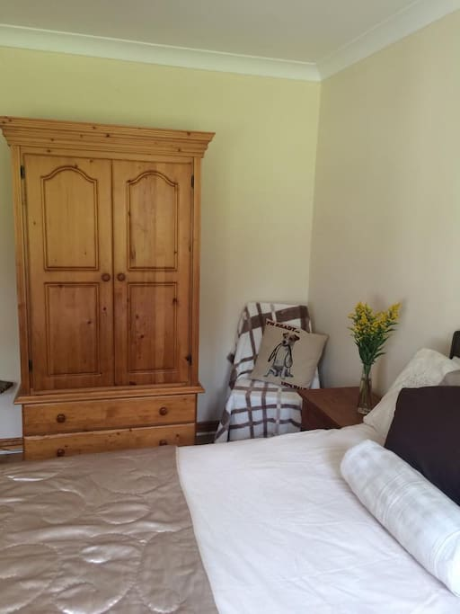 Double room complete with wardrobe, chair, chest of drawers and 2 bedside cabinets.