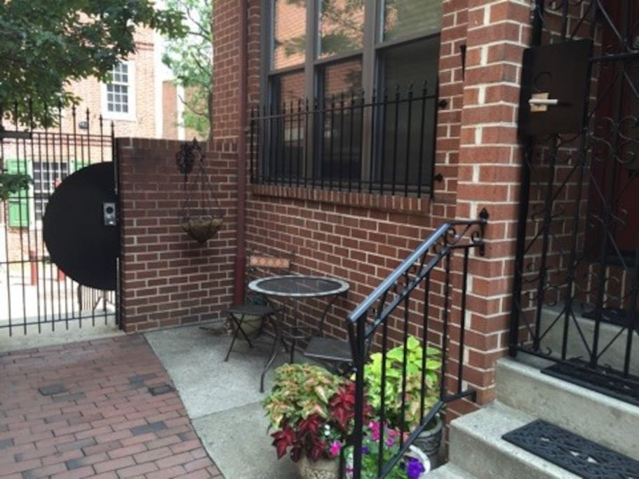 View of our seating area, front door and side gate that leads directly onto Elfreths Alley!