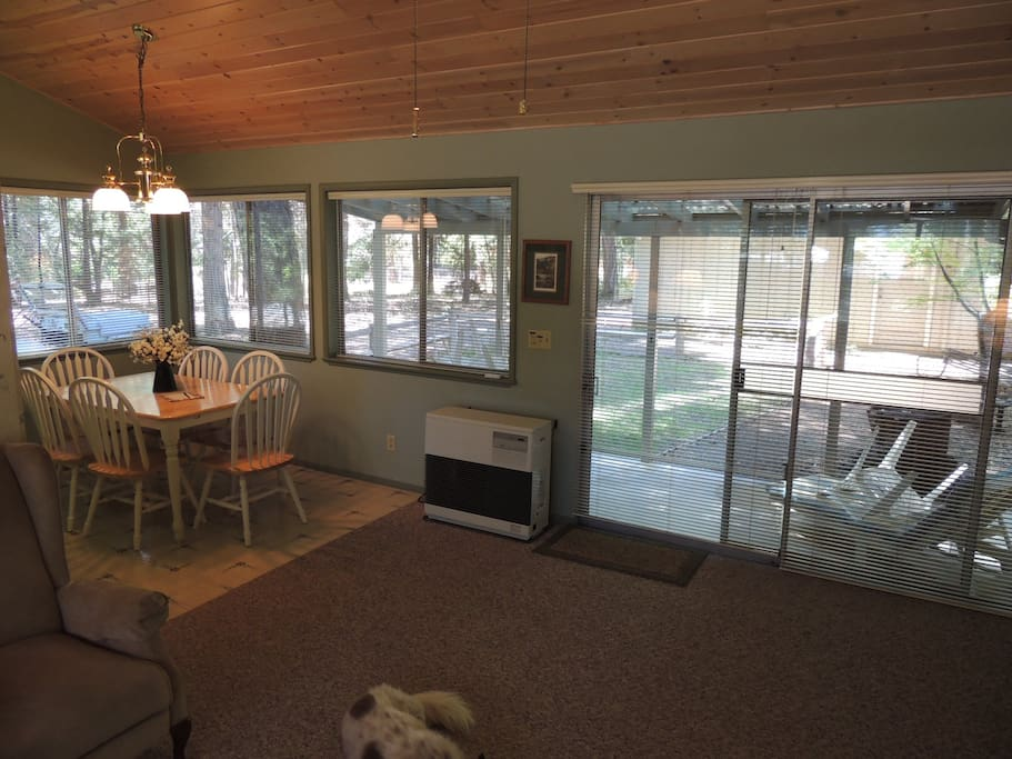 Living and dinning room view of outdoors facing the backyard