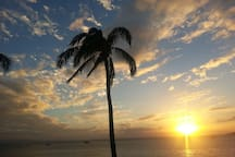 Enjoy a glass of wine while viewing a Maui sunset.