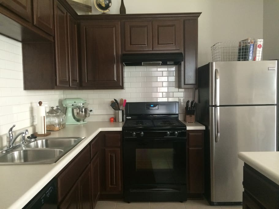 Kitchen with island and gas stove & oven