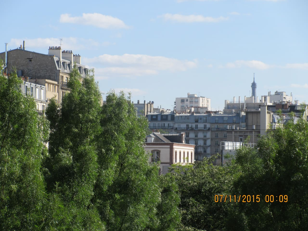 View of Eiffel Tower and Park from Balcony of Apartment