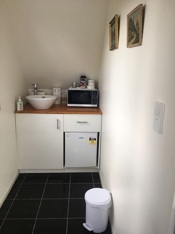 Kitchenette with Microwave, Toaster, Kettle and Fridge.