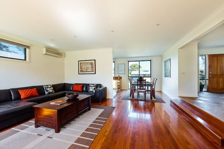 Polished floorboards throughout the open plan living area