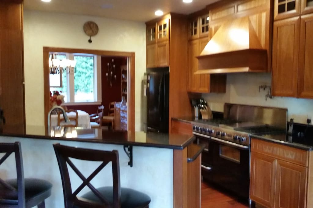 Beautiful Kitchen, awsome 5 star range, pot filler, dishwasher, refrigerator conected to private dining room and breakfast nook.