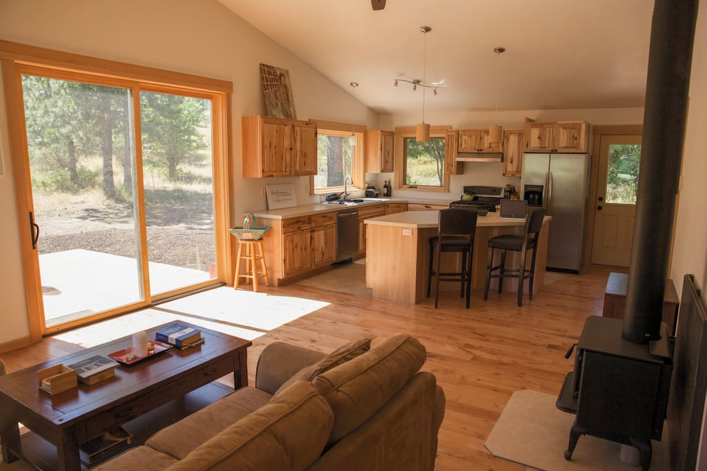 Beautiful living room and kitchen with vaulted ceilings.